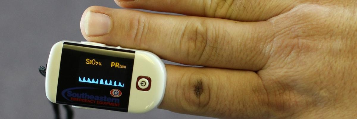 Pulse oximeter on a finger.